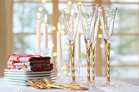 shallow focus photography of gold-colored forks and crystal clear champagne glasses