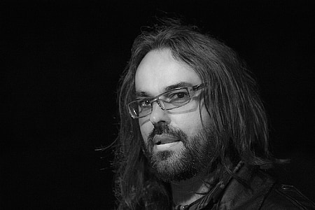 man wearing silver framed eyeglasses