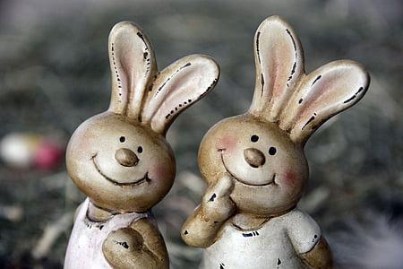 two white rabbit figurines