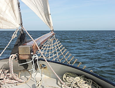 photo of sail boat on body of water