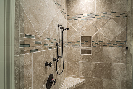 black shower on whit wall