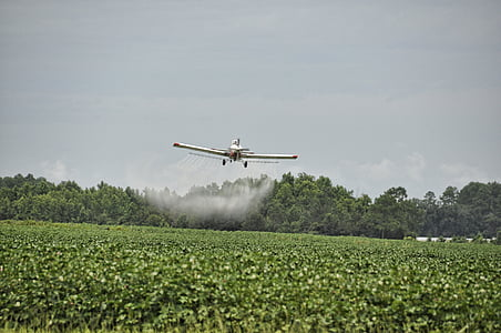 white monoplane spraying fertilizer