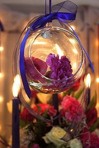 purple flowers in clear glass bowl
