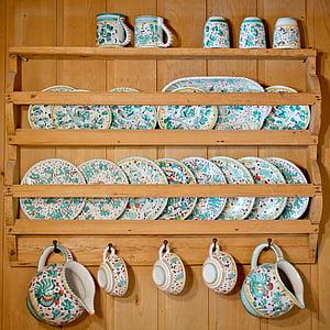 brown wooden floating dinnerware shelf with blue floral ceramic dinnerwares