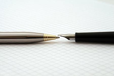 grey ballpoint pen and black fountain pen