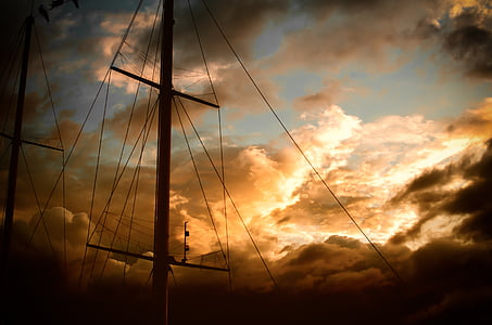low angel photo of sailboat sail stand during golden hour