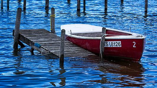 jon boat beside beach dock