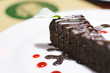 closeup photo of chocolate cake on white ceramic plate
