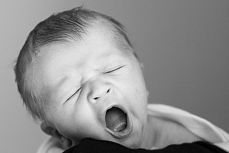 grayscale photo of yawning baby
