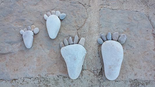 two pairs of feet stone formations
