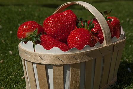 bunch of strawberry on brown basket