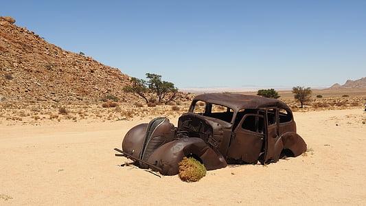 abandoned brown vintage car on desert