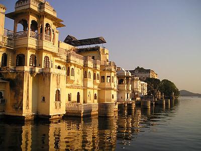 concrete buildings near body of water