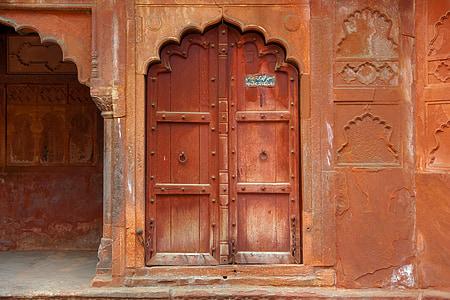 close brown side-by-side door