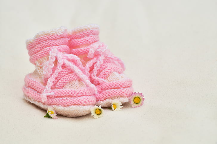 toddler's pair of pink bootees