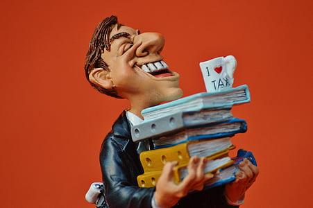 laughing man holding books figurine