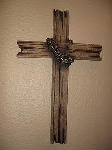 brown wooden cross wall display