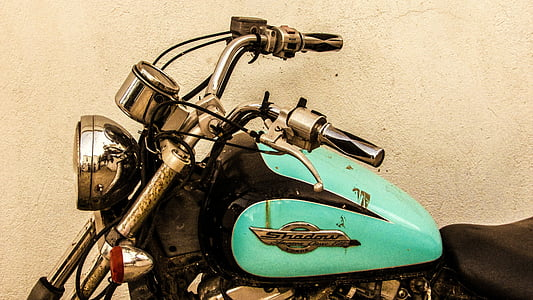 teal and black cruiser motorcycle