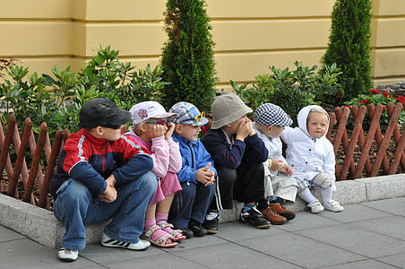 group of children sitting on floor at during time