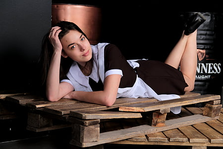 woman in white and black maid suit on pallet