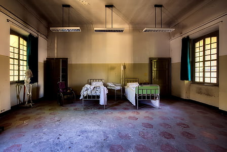two grey hospital bed frames and light turned off