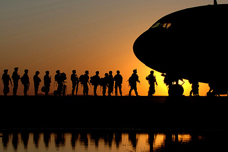 silhouette photo of soldiers