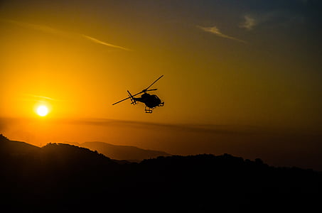 silhouette of helicopter with sunlight