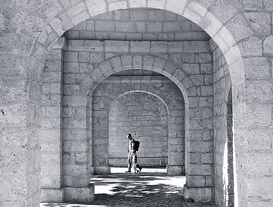 grayscale photo of person in hallway