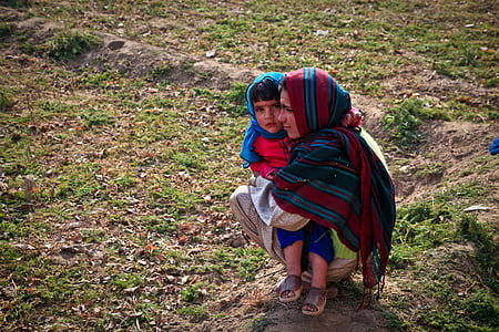 female carrying child