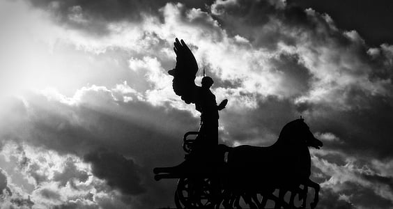silhouette of angel riding carriage