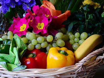 basket of fruits, vegetables and petaled flowers