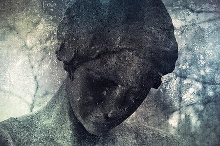 gray concrete human statue