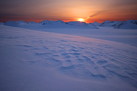 mountain covered with snow at sunset
