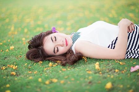 woman lying on lawn