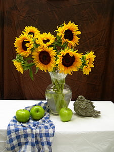 sunflowers in clear glass vase