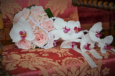bouquet of pink roses on top of armchair