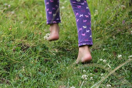 person in purple animal print pajama pants on grass field
