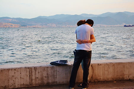 couple embracing near ocean