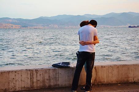 couple embracing near ocean