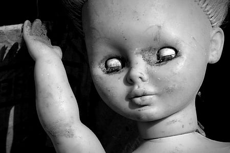 greyscale photo of doll