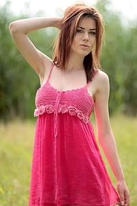 woman in red spaghetti strap dress