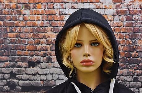 female mannequin wearing black hoodie
