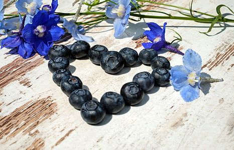 heart-shaped blueberries with blue petaled flowers