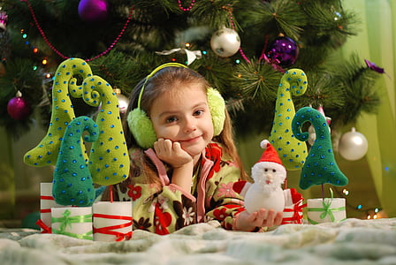 girl in front on the Christmas tree