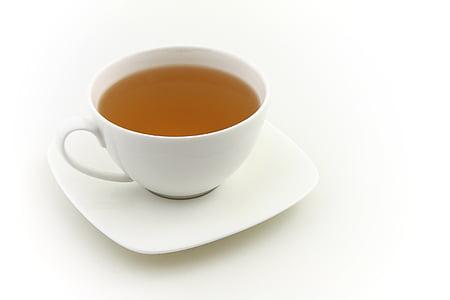 filled white ceramic teacup against white background