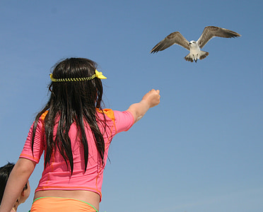 girl feeding bird