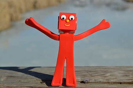red character figurine on wooden surface