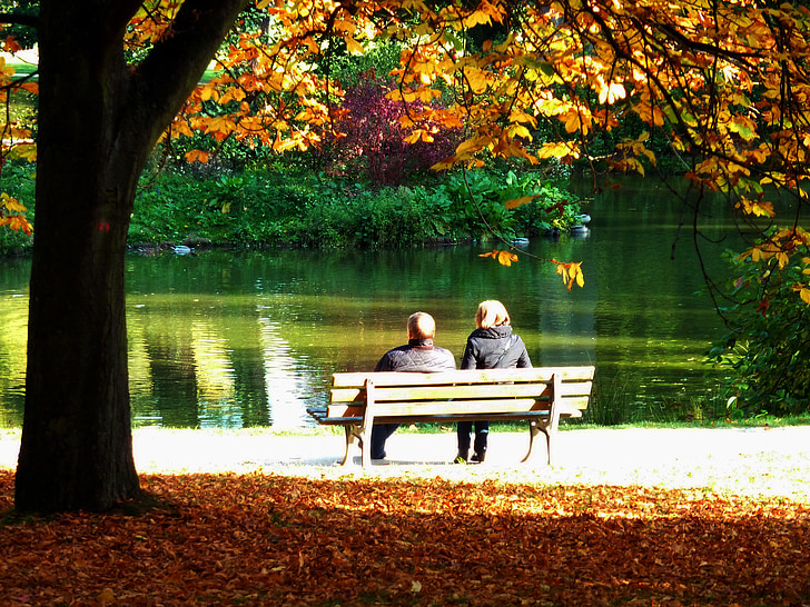 Royalty Free Photo Two People Sitting On Brown Outdoor