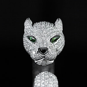 silver-colored clear gemstone encrusted cat pendant