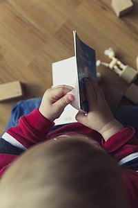 boy holding storybook